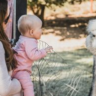 Baby and Alpaca, Morning Song Farm, CA | Photo by Anna Chasovnikov