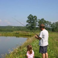 Guests fishing in the farm pond.